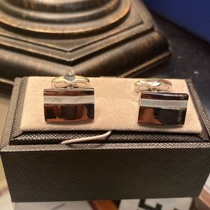 Silver and white cufflinks